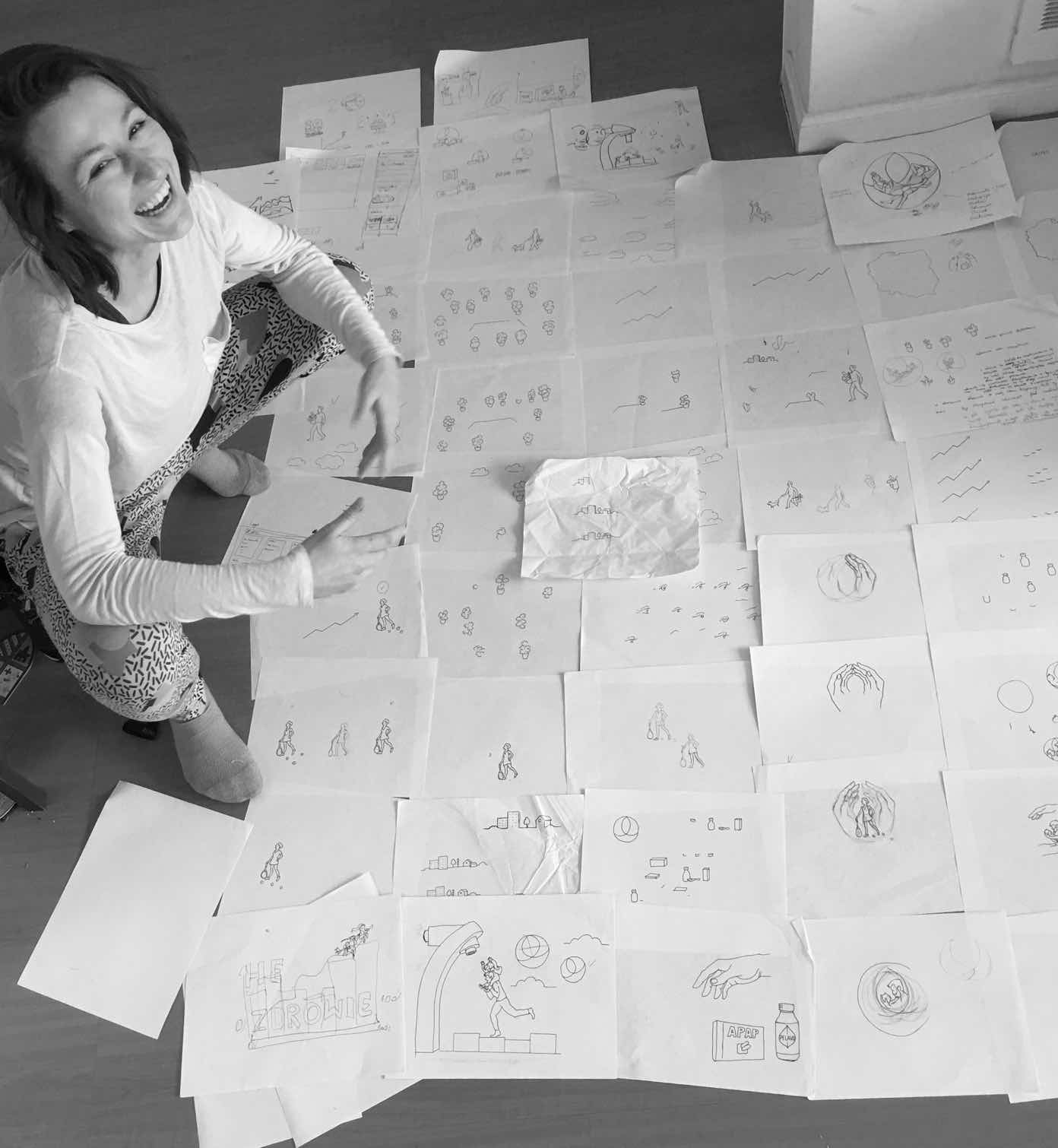Ania in front of floor filled with sketches